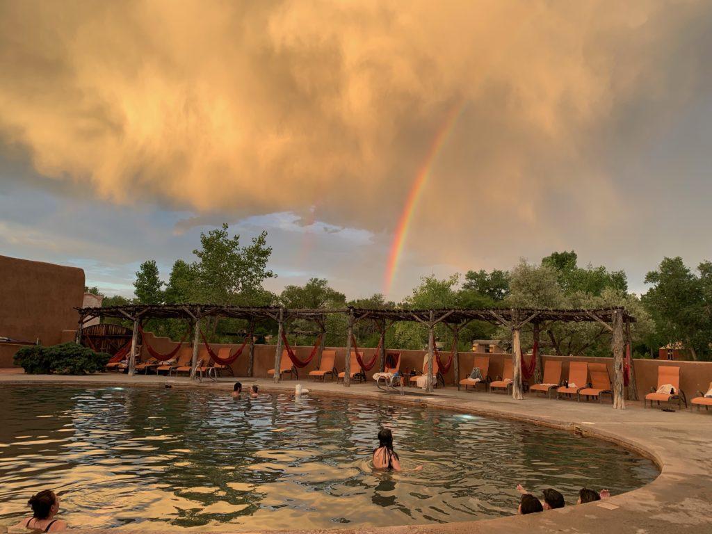 Legendary Healing Waters of Ojo Caliente soaking pool with rainbow