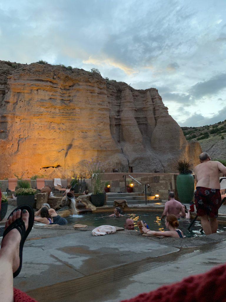 Legendary Healing Waters of Ojo Caliente soaking pool and cliffs