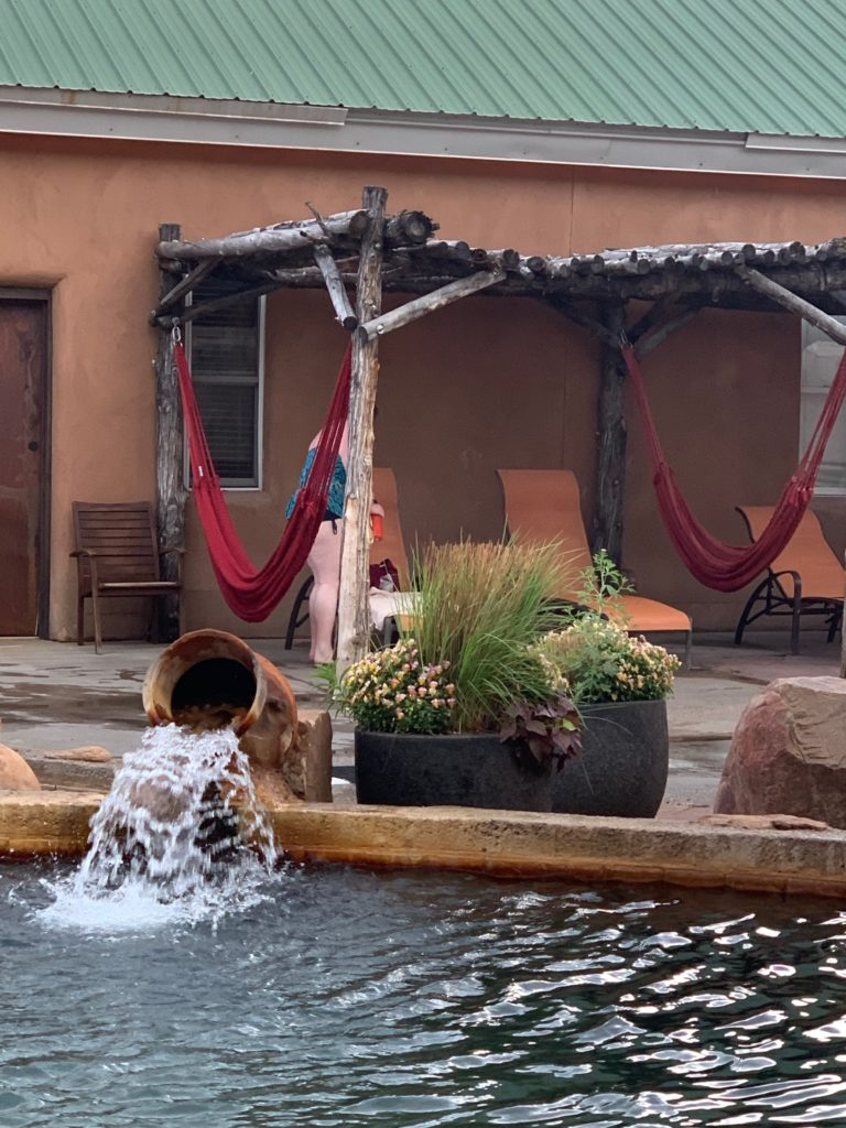 Legendary Healing Waters of Ojo Caliente soaking pool and hammocks.